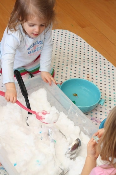 "toddlers digging for ""diamonds"" in a snowy sensory bin"