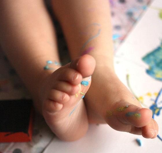 Paint splattered toddler feet