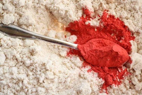 spoonful of tempera paint powder in bowl of flour