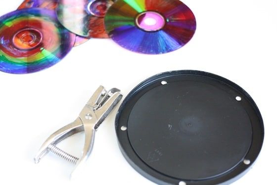 coloured CDS, coffee can lid, hole punch