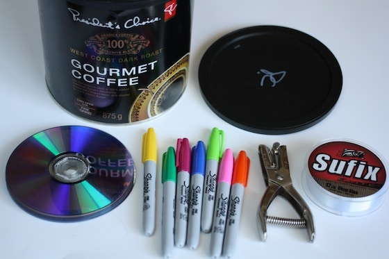coffee can, cds, sharpies, hole punch, fishing line