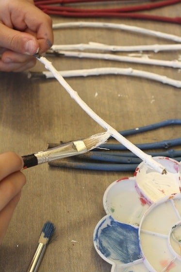 painting white twigs for stars