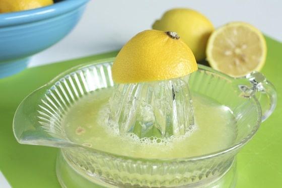 glass lemon juicer and lemons