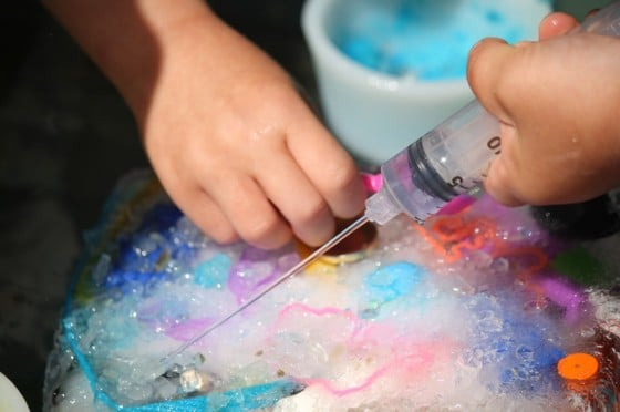 Simple water play activity for kids to excavate toys out of ice with water, salt and small tools