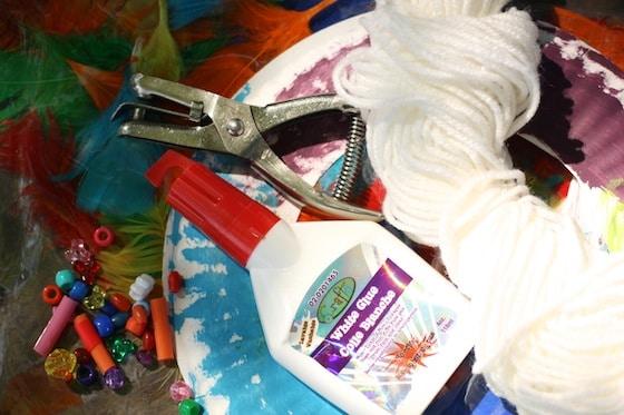 glue, yarn, paper plate, beads