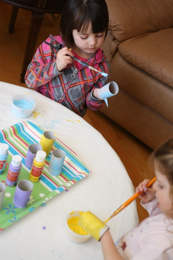 toddler and preschooler painting toilet roll chicks