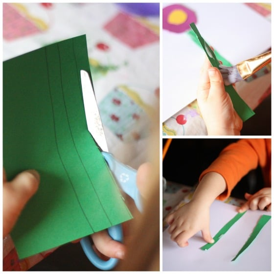 preschooler cutting paper flower stems