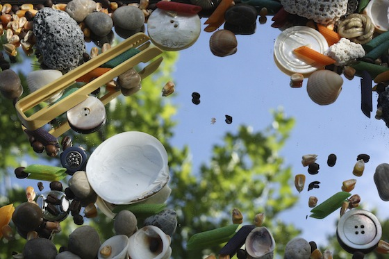 sensory play on a mirror with small loose parts