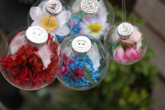 hanging plastic ornaments filled with artificial flowers