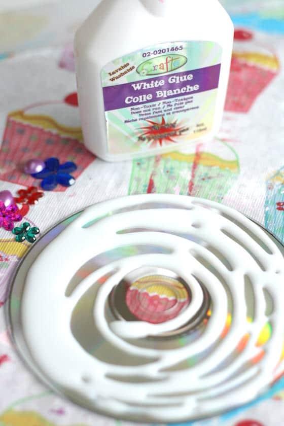 glue, craft gems, cd with glue on it