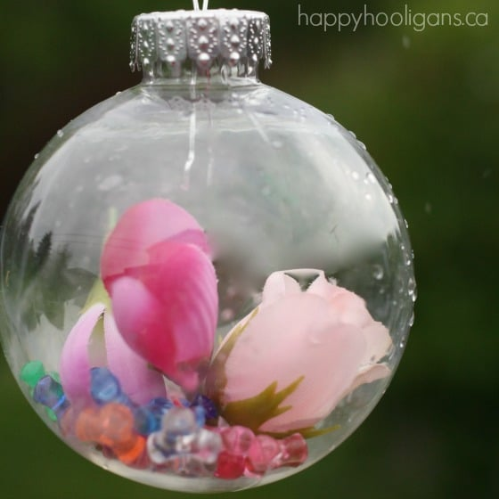 pink flowers and beads dropped into clear plastic ornament