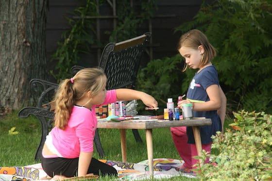 girls making crafts outside