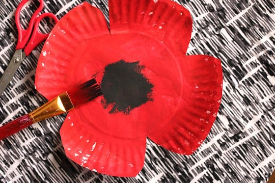 paper plate cut into poppy shape