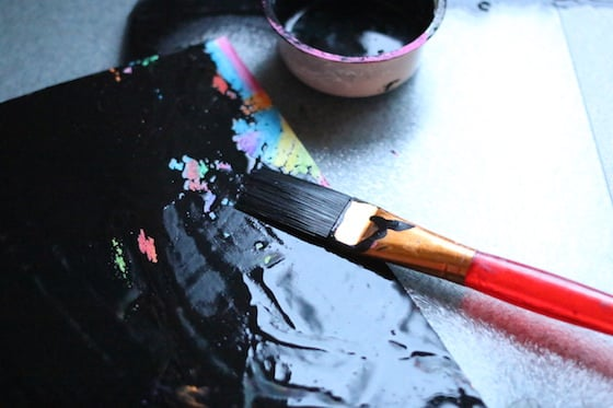 painting over crayons with black tempera paint