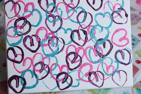 Hearts stamped on canvas with toilet rolls dipped in paint