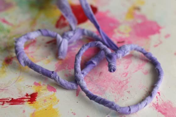 pipe cleaner hearts wrapped in fabric strips for Valentines day