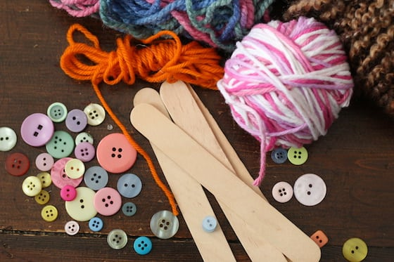 popsicle sticks, buttons, and yarn