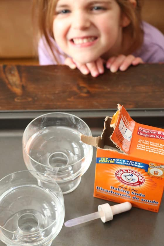 baking soda and vinegar on a baking sheet