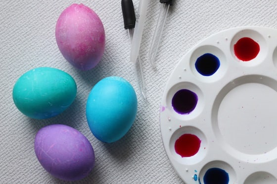 dyed eggs, medicine droppers and liquid watercolours in a pallet