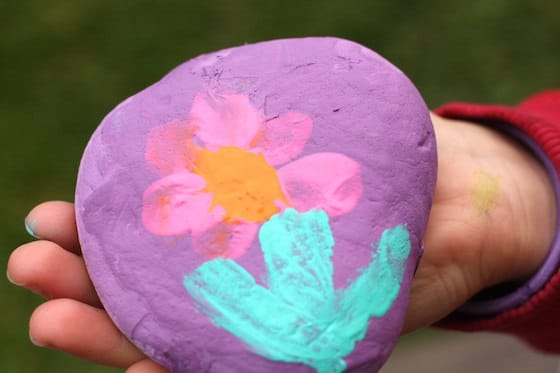 flower painted on rock by a child