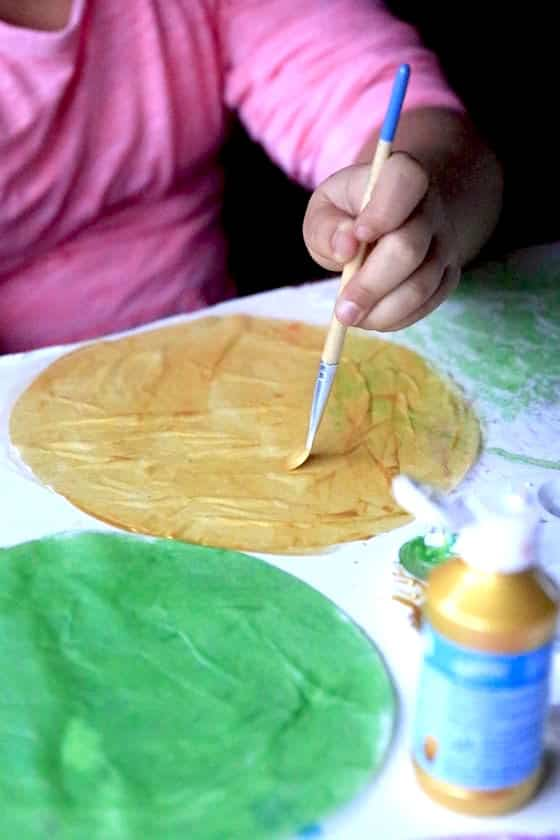 Painting coffee filters with metallic kid's paint