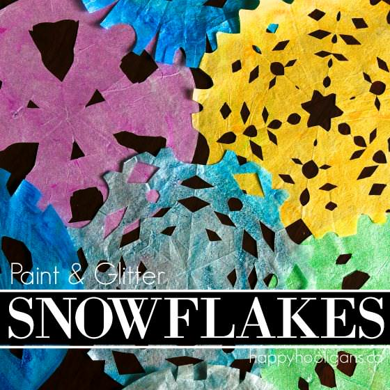 Painted, glittered coffee filter snowflakes