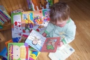Baby looking at books