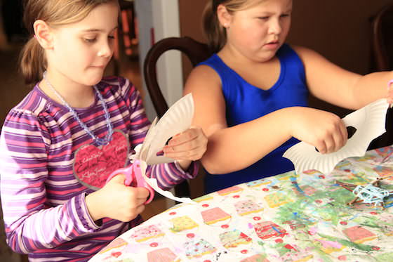 Girls cutting masks out of paper plates
