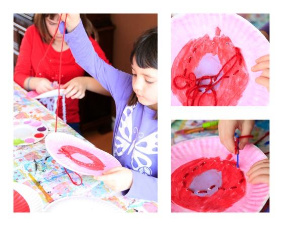 Kids lacing hearts on paper plates for Valentines craft