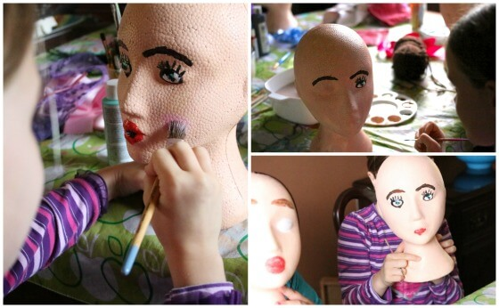 Painting faces on styrofoam heads