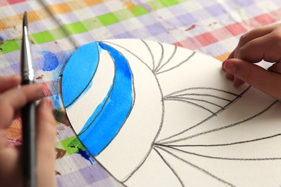 paper egg decorated with crayon and watercolours
