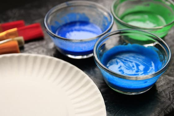Paint brushes, Paper Plate and 3 bowls of Homemade Puffy Paints