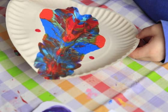 child making butterlies with rorschach painting process