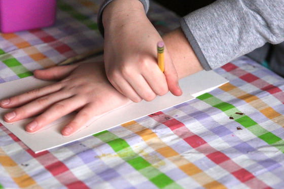 child tracing her hand