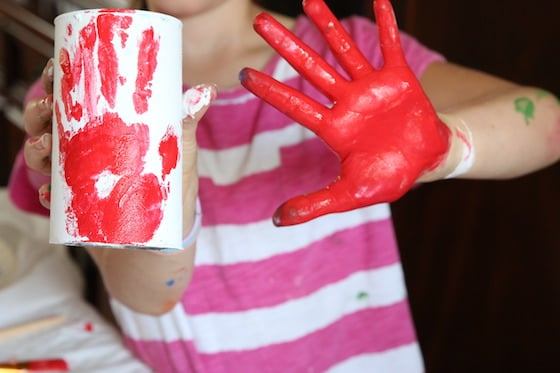 Red hand print on white can