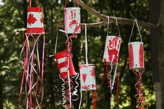 Red and White Windsocks Hanging from Tree