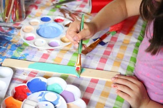 painting a paint stir stick