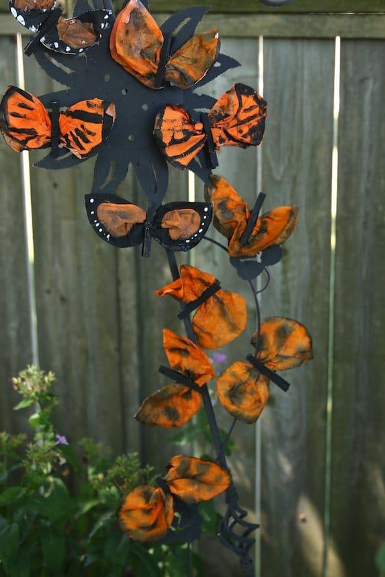 coffee filter monarchs in the garden