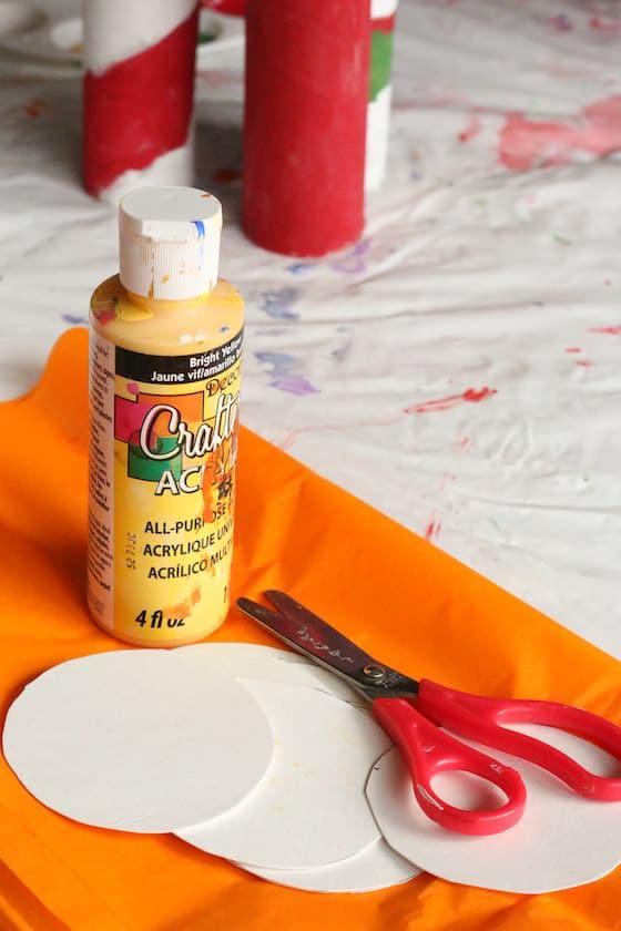 Yellow paint, orange tissue paper, kids scissors