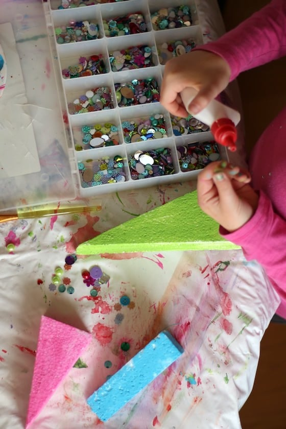 kids decorating christmas tree table toppers with gems