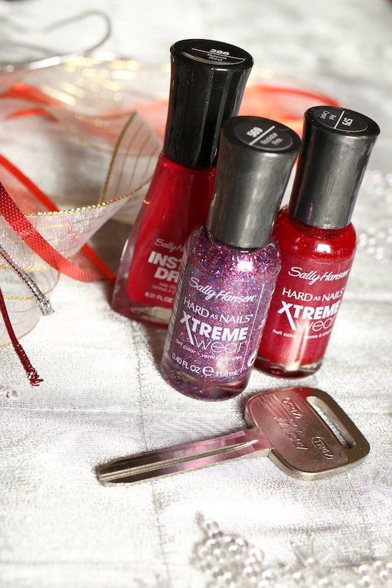 Key, ribbon and red nail polish