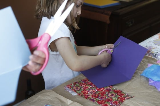 child cutting card stock