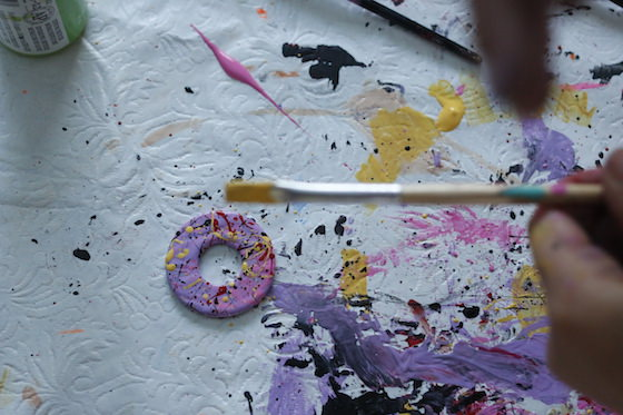 Child splatter painting a washer