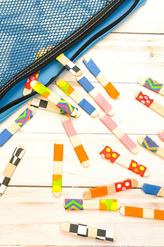 Craft Stick Dominoes spilling from pencil case