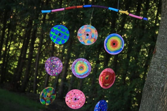 Painted CDs hung from colourful stick