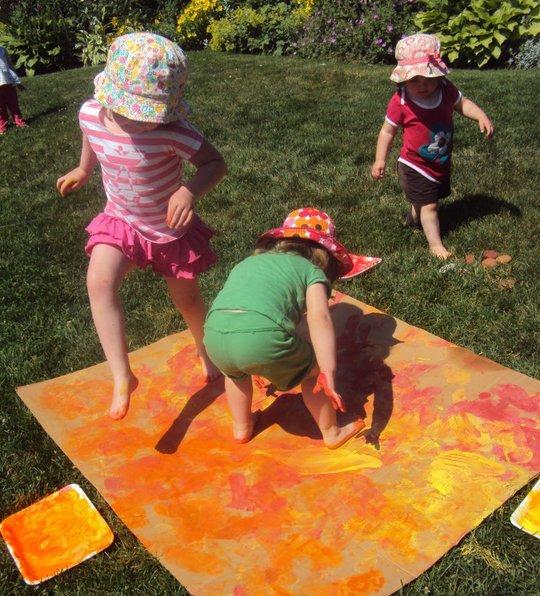 kids making footprint art