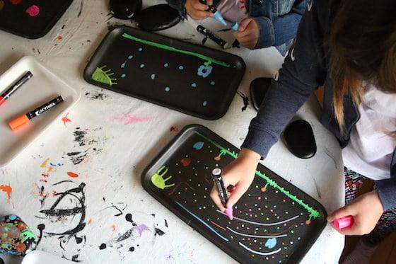 kids colouring on sytorofam produce trays