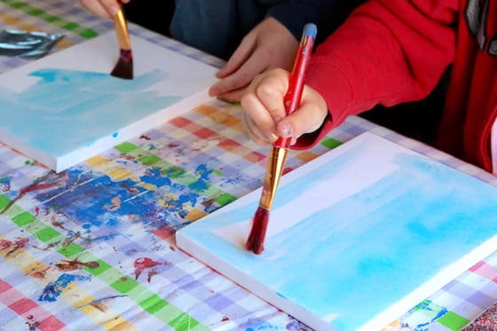 Kids painting canvas blue watercolours