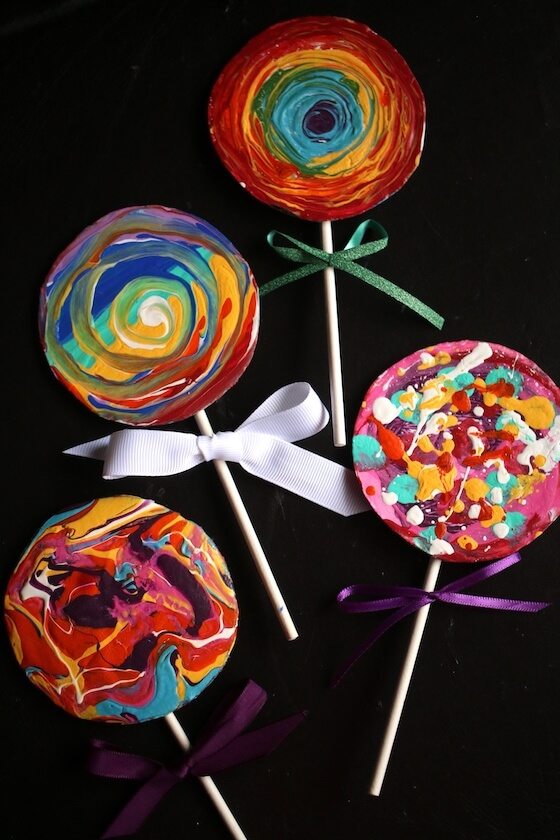 4 colourful painted lollypop Christmas ornaments