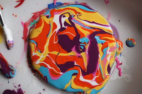 paint drizzled on cardboard circle